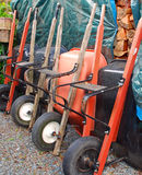 All Lined Up. Wheelbarrows lined up in gardening shed Royalty Free Stock Image