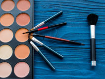 All for make-up. Cosmetics on the table in studio stock photos