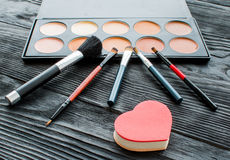 All for make-up. Cosmetics on the table in studio Stock Image