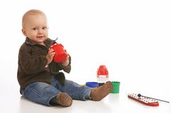 All mine. Baby-boy playing with his toys royalty free stock images