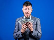 Is it all mine. Rich businessman with us dollars banknotes. Currency broker with bundle of money. Bearded man holding. Cash money. Making money with his own stock image