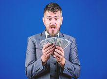 Is it all mine. Rich businessman with us dollars banknotes. Currency broker with bundle of money. Bearded man holding. Cash money. Making money with his own stock photos