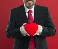 All my love is for you. diseased heart. Love and romance health care. mature man hold valentines heart. February holiday. Happy man with big red heart royalty free stock photo