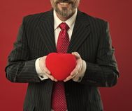All my love is for you. diseased heart. Love and romance health care. mature man hold valentines heart. February holiday. Happy man with big red heart stock image