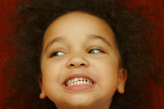 These Are All My Teeth. A young mixed race girl smiling broadly and showing all her teeth Royalty Free Stock Image