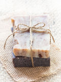 All natural handmade baobab and chocolate soaps. Vertical photo of two bars of homemade all natural hand crafted baobab and chocolate soaps arranged in a pile on Stock Photos