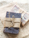 All natural handmade chocolate and baobab soaps. Vertical photo of two bars of homemade all natural hand crafted chocolate and baobab soaps on a burlap Stock Images
