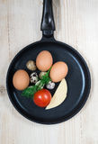 All that is necessary for eggs. On the table in the pan are products for eggs Stock Photography
