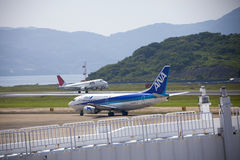 All Nippon Airways (ANA) airplane. 19 dec 2015 Airport Nagasaki. Japan. All Nippon Airways (ANA) and JAL airplanes in airport of Nagasaki (NGS), Omura Stock Photos