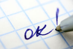 All is ok. Word on grid paper Royalty Free Stock Photos