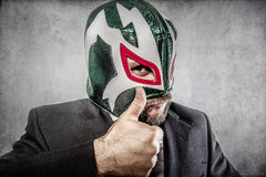 All it is ok, aggressive executive suit and tie, Mexican wrestle Stock Photos