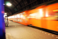 All onboard!. A departing train at Amsterdam Central Station Stock Images