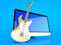 A All in one computer with a Guitar Royalty Free Stock Image