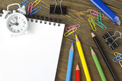 All paint, colored pencils and paper clips Royalty Free Stock Photography