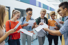 We All Passed!. Happy students have received their exam results in high school. They are cheering and celebrating Stock Photos