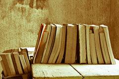 Books on the acient table. All the passion for reading and the great books Royalty Free Stock Image