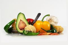 All for paste. Arrangement from avocado, yellow and red pepper and the Italian paste royalty free stock photos