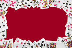 All playing cards around the red background Stock Image