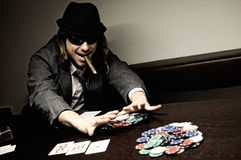 All in Poker. Man with hat and glasses playing underground poker royalty free stock image