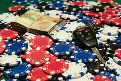 All In Poker Pot. Poker chips, money, and car keys in the pot Royalty Free Stock Images
