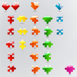 All possible shapes of puzzle pieces in different colors Stock Photos