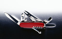 All purpose tool. Multipurpose tool with knife, scizzors, and can opener Stock Photography