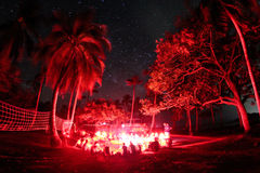 All red in Isla Fuerte. An Artificial Lights up the trees arround a camp fire in Isla Fuerte, Colombia Stock Photos