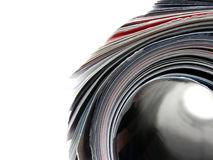 All rolled up. Macro of a rolled magazine Royalty Free Stock Images