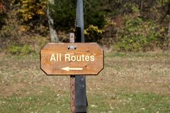 All Routes wooden signboard with arrow royalty free stock photo
