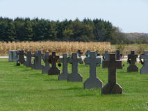 All in a Row. Country cemetery with rows of plots mimicking rows of corn - copy space in lower left Royalty Free Stock Images