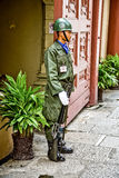 All the Royal Grand Palace. At the entrance of the large royal palace stand in front of guards in khaki uniforms. On arms fastened bayonet. He is so not moving stock images