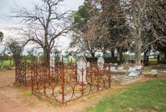 All Saints Church Cemetery at Dusk. HENLEY BROOK,WA,AUSTRALIA-JULY 15,2016: All Saints Church cemetery with fenced in headstones at twilight in Henley Brook royalty free stock photo