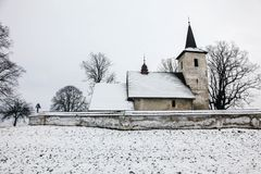 All Saints church in Ludrova village, northern Slovakia. LUDROVA, SK - DECEMBER 31, 2017: All Saints church in Ludrova village, northern Slovakia. This rare royalty free stock photography