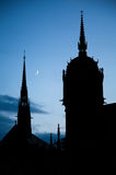 All Saints` church in Lutherstadt Wittenberg, Germany at night with crescent moon Stock Photos