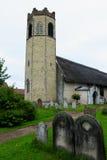 All Saints Church, Old Buckenham, Norfolk, England. 14th Century All Saints Anglican Church, Old Buckenham, Norfolk, England with its thatched roof and unusual stock photos