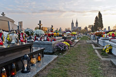 All Saints' Day. Graves with flowers and candles on cemetery during All Saints' Day Royalty Free Stock Photo