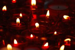 Many candels put on the graves on the All Saints` Day Stock Photography