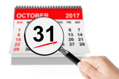 All Saints Day Concept. 31 October 2017 calendar with magnifier. On a white background Stock Images