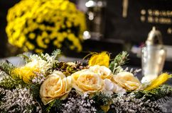 All Saints Day. Flower decoration on the tomb in All Saints Day Royalty Free Stock Image