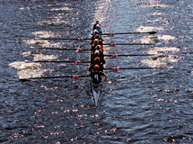 We are all in the same boat. Young women athletes rowing boat Stock Images