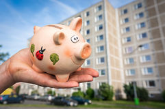 All savings money from piggy bank to pay for the dream home Stock Photo