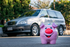 All savings money from pink ceramic piggy bank to pay for the dr Royalty Free Stock Photo