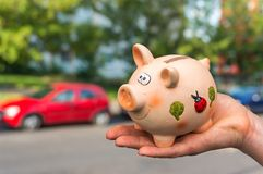 All savings money from pink ceramic piggy bank to pay for the dr Royalty Free Stock Image