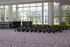 All security guards sitting on the ground Stock Image