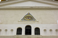 All seeing eye. Eye of GOD, masonic symbol at the entrance of a church stock photography