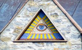 All-seeing eye of God - a mosaic of wall background medieval church. Eye of Providence - famous symbol of Masons and Illuminati stock photography
