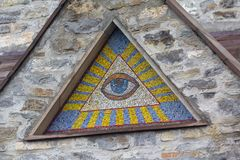 All-seeing eye of God - a mosaic of wall background medieval church. Eye of Providence stock photography