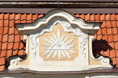 All Seeing Eye inside triangle with beams. Architecture detail, VIlnius old town stock image