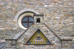 All-seeing eye - a mosaic of wall background. Medieval royalty free stock photos