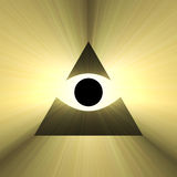 All seeing eye pyramid with light flare. All seeing eye of providence with rays of powerful white light flare. Eye with triangle. Religious symbol. Extended Royalty Free Stock Photography